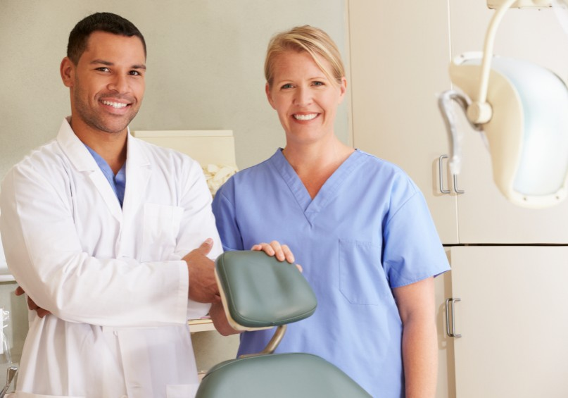 Portrait Of Dentist And Dental Nurse In Surgery